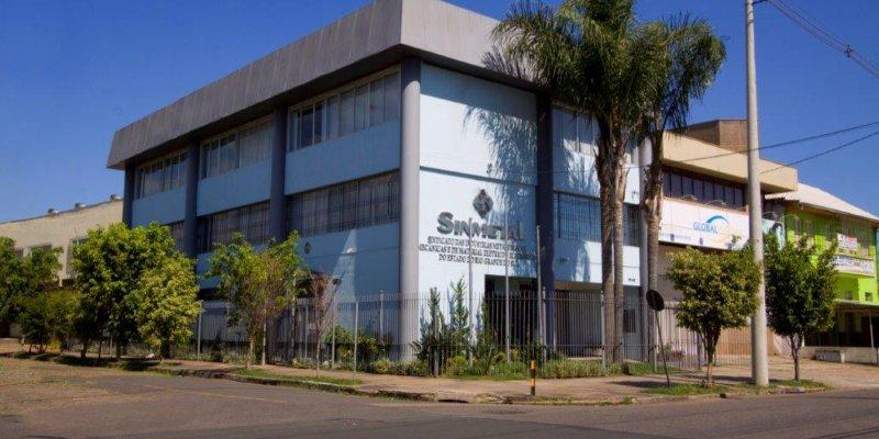 Imagem da sede do Sinmetal - um prédio cinza